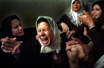 MOTHER AND FAMILY MOURN MOHAMAD AL MADHON IN THEIR FAMILY HOME IN GAZA.