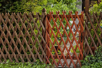 Wooden lattice grid fence. Garden entrance
