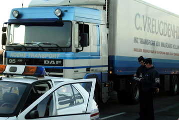 French policemen checks lorries on a roadblock at the entrance of Lesquin's freight center on Novemb..