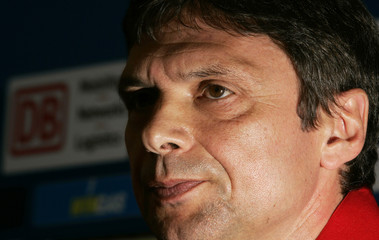 Hertha Berlin's new coach Heine addresses a news conference in Berlin