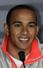 McLaren's Hamilton smiles during a news conference before the United States F1 Grand Prix in Indianapolis