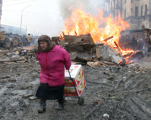 CHECHEN VENDOR SAVES HER GOODS FROM BURNING MARKET IN GROZNY.
