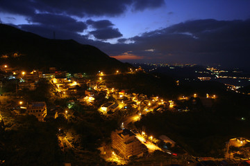 A night view of mountain roads are seen during sunset in Jioufen, Taiwan