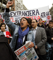 Protesters rally to mark the second anniversary of the US-led war on Iraq in Madrid.