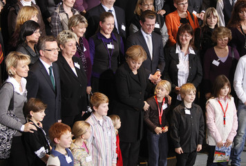 German Chancellor Merkel poses during reception in Berlin