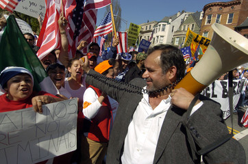 Protestors use bullhorn during march for immigrant rights in Washington