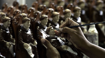 Souvenir statues of Friar Antonio de Sant'Anna Galvao are made in a factory in his hometown city of Guaratingueta