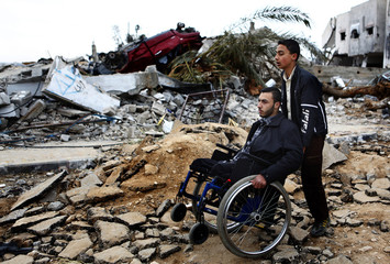 Palestinians survey ruins of destroyed houses on outskirts of Jabalya