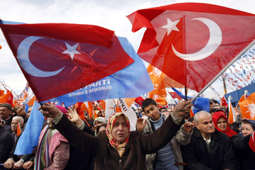 Supporters waving flags cheer for Turkey's Prime Minister Tayyip Erdogan in Istanbul