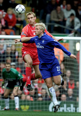 LIVERPOOL'S HYPPIA AND CHELSEA'S GUDJOHNSEN JUMP FOR THE BALL ATANFIELD.
