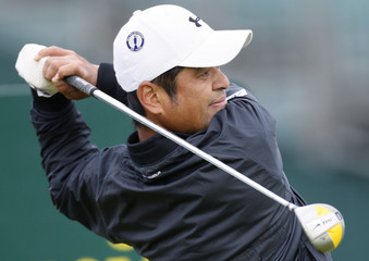 Japan's Toshi Izawa hits his tee shot off the 3rd tee during a practice session at the 2007 British Open Golf Championship in Carnoustie