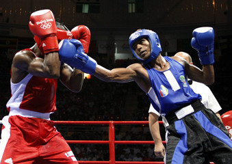 Leon of Cuba fights Julie of Mauritius during their men's bantamweight (54kg) semi-final boxing match at the Beijing 2008 Olympic Games