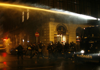 Hungarian police use a water cannon against anti-government demonstrators in Budapest