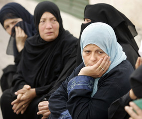 Palestinians react after their relative was killed during clashes with Israeli troops in Gaza