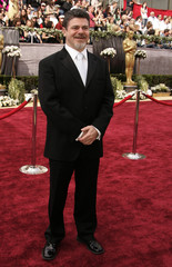 Composer Santaolalla of Argentina arrives on the red carpet at the 78th annual Academy Awards in Hollywood