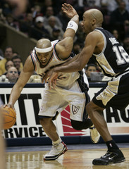New Jersey Nets Carter tries to get by San Antonio Spurs Bowen.