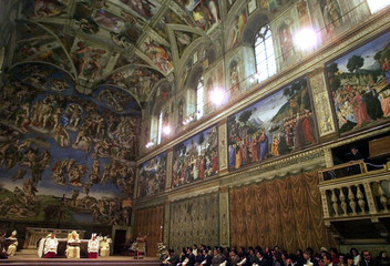 Pope John Paul II listens to prayers during a special Baptism ceremony in the Sistine Chapel January..