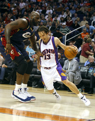 Phoenix Suns' Steve Nash drives on Cleveland Cavaliers' Shaquille O'Neal in the fourth quarter of an NBA basketball game in Phoenix