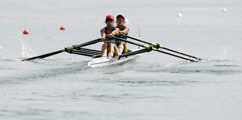 Camila Carvalho and Luciana Granato of Brazil compete in the women's lightweight double sculls Final C rowing competition of the Beijing 2008 Olympic Games