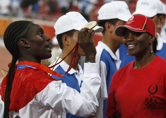 Harper of U.S. celebrates winning women's 100m hurdles final at the Beijing 2008 Olympic Games