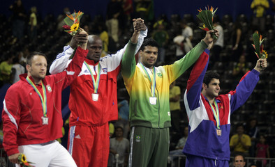 Despaigne of Cuba, Morgan of Canda, Correa of Brazil and Diek of the Dominic Republic stand on the podium after the Men's -100kg judo competition at the Pan American games in Rio de Janeiro
