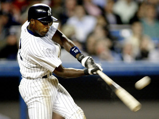 YANKEES ALFONSO SORIANO HITS A HOME RUN OFF SEATTLE MARINERS PITCHERJOEL PINIERO.