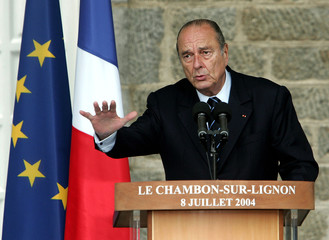 French President Jacques Chirac delivers a speech in a school in Chambon-sur-Lignon , July 8, 2004. ..
