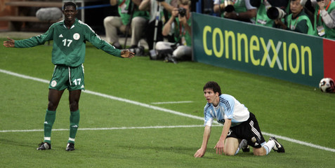 Nigeria's Adeleye reacts after Argentina's Messi was awarded penalty during FIFA World Youth ...