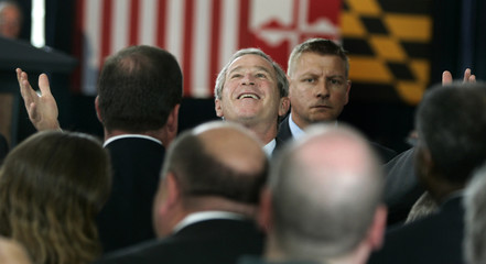 U.S. President George W. Bush opens his arms to workers at the Calvert Cliffs Nuclear plant in Maryland.