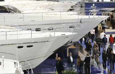 Visitors look at  yachts during the first day of the 39th 'International Boat Fair' in Duesseldorf