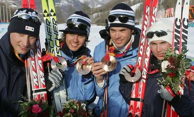 Finland's Hannu Manninen, Anssi Koivuranta, Antti Kuisma and Jaakko Tallus (L-R) present their bronz..