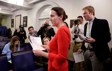 Deputy White House Press Secretary Lindsay Walters hands out a statement relating to the firing of the Director of the FBI James Comey by U.S. President Donald Trump at the White House in Washington