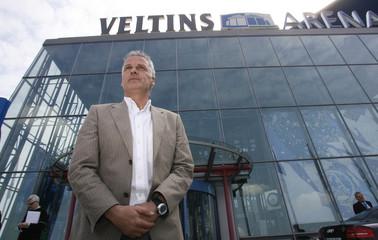 Schalke 04's prospective coach Rutten poses in front of the Veltins-Arena in Gelsenkirchen