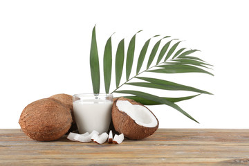 Beautiful composition with coconut milk on white background