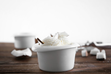 Fresh coconut ice cream on wooden table