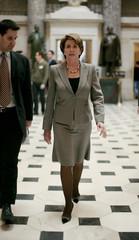U.S. House Speaker Nancy Pelosi walks to the House floor before the Iraq resolution debate in Washington