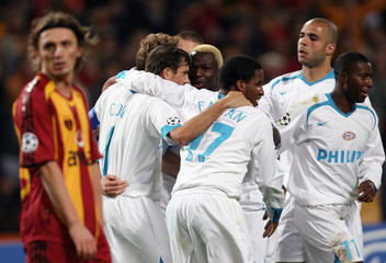 PSV Eindhoven players celebrate a goal by Jan Kronkamp against Galatasaray in Istanbul