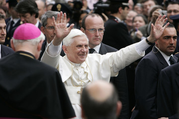 Pope Benedict XVI greets the crowd outside his residence in the Vatican.