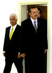 TAYYIP ERDOGAN IS FOLLOWED BY TURKISH CYPRIOT PRIME MINISTER EROGLOU INNICOSIA.