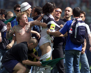 Juventus supporters invade the pitch snatching the shorts and shirt of Filippo Inzaghi during the ma..