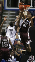 Texas A&M forward Elonu blocks a shot by BYU guard Abouo during the first half of their opening round NCAA basketball game in Philadelphia