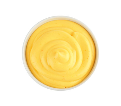 Bowl with cheese sauce on white background