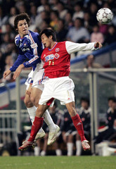 Havenaar Mike of Japan's Yokohama F. Marinos fights for the ball against Man Pei Tak of Hong Kong's South China during a friendly football match in Hong Kong