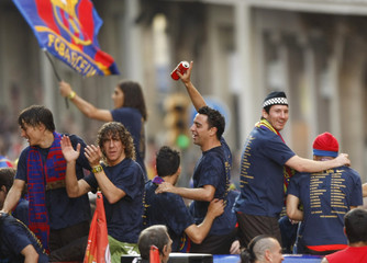 Members of Barcelona soccer team wave to the crowd as they celebrate their Champions League victory in Barcelona