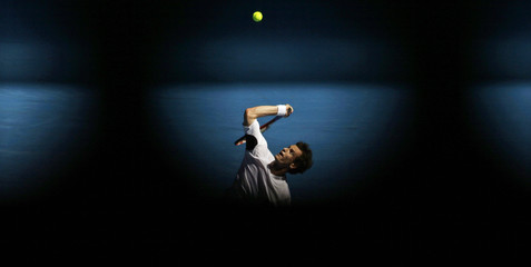 Britain's Murray serves to Spain's Verdasco during their match at the Australian Open tennis tournament in Melbourne
