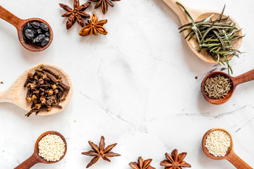Cooking with spices,vanilla, cinnamon on kitchen table background top view mock-up