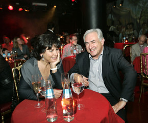 IMF Chairman Strauss-Kahn and his wife Sinclair watch a tango show in Buenos Aires