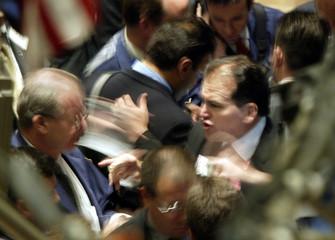 TRADERS WORK ON FLOOR OF NEW YORK STOCK EXCHANGE.