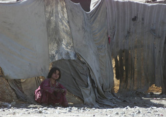 AFGHAN GIRL IN A REFUGEE CAMP ON THE OUTSKIRTS OF QUETTA.