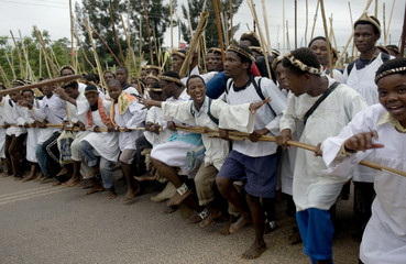 Members of the Shembe faith hold sticks as they dance to Nhlangakazi Mountain during the annual pilgrimage near Inanda
